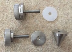 A selection of the components of the spike, adjusters, lock-nuts, washers and mounting bolts