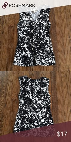 Banana Republic sleeveless vneck top Black and white sleeveless v neck top from Banana Republic.  Worn and washed a couple times.  Fits true to size.  Comes from a smoke free home! Banana Republic Tops