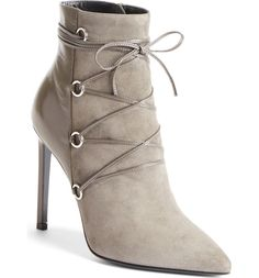 Creating a bold yet chic statement with these lace up booties in a lush grey suede.