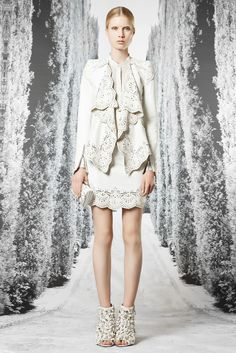 A #RobertoCavalli SS 2013 white outfit adorned with laser cut designs and micro-studs!