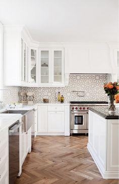 Interesting backsplash tile & love the wood floors in a chevron or herringbone pattern. The+Most+Beautiful+Kitchen+Backsplashes+We've+Ever+Seen+via+@domainehome