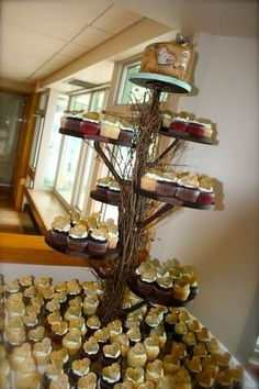 oh I love this cupcake tree. would be perfect :)   My Photo Album Wedding Cakes Photos on WeddingWire