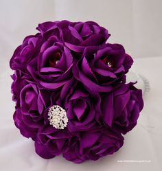 purple silk rose brides bouquet of roses with diamante brooch detail