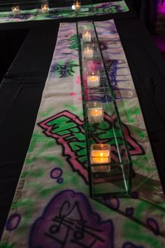 Hand painted graffiti table runners enhanced the theme of this party designed by Sabella Berman Events of Florida.