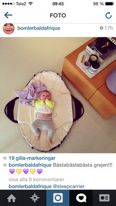 Najell - SleepCarrier Swedish Baby Carry Cot - Harness. Baby playing during coffee break. Bärsele