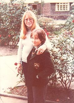 1975 - Cynthia and 12 year-old Julian, wearing his Kingsmead school uniform, posing for visiting fan Rita Hansen in the rose garden of their home called Rosebank. In 1974 Cyn bought Rosebank a bungalow in Meols, a village in the Wirral close to Hoylake. Cyn loved living close again to old friends and family - especially to her mother in Hoylake where she grew up. Photo sold thru the Beatles fanzine, The Write Thing.