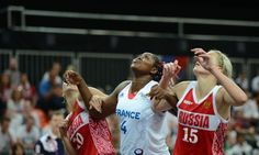 Where's the ball? Russian centre Nadezhda Grishaeva (R) and Russian forward Ilona Korstin (L) vie with French centre Isabelle Yacoubou watch for the catch during their women's preliminary round group B basketball match. France won 65 to 54
