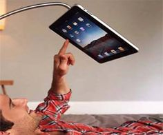 Watch movies or read books hands free on your iPad while you lie down on your bed with this hands free iPad stand. Able to be mounted anywhere, this 360 degree swiveling iPad stand has endless applications such as displaying recipes will you cook dinner. Ipad Floor Stand, Ipad Stand, Tablet Stand, Tech Gadgets, Cool Gadgets, Ipad Hacks, Ipad Holder, Tablet Holder, Cool Inventions
