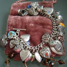 Sterling heart charm bracelet.   Hearts from the Victorian to 1940s including Walter Lampl enamels