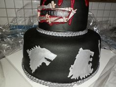 starks and lannisters. game of thrones cake. i would def. add more detail for the groom's cake