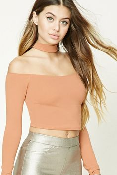 A stretch-knit crop top featuring a choker neckline, off-the-shoulder design, a racerback, and long sleeves.