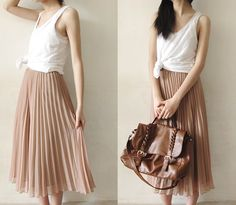 I want this skirt. Perfect for the weekend or with a white blazer at the office.