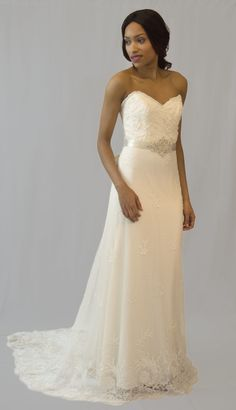 2256 by Tara Keely, size 10. RRP: £2000, now £1000 - Ivory beaded lace with appliquéd belt. Available to try on at Betty Gets Hitched.