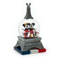 Deux grandes vedettes Disney sont en excursion dans ce mini globe Mickey et Minnie Mouse Paris, conçu sur le modèle de la Tour Eiffel sur une base représentant le drapeau français.