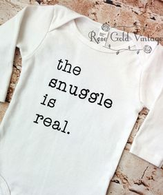 You loved our original Snuggle is Real onesie so much, we decided to do a little re-mix on white! The snuggle is real. Perfect for your new little one, or makes a great gift. A Rose Gold Vintage exclu
