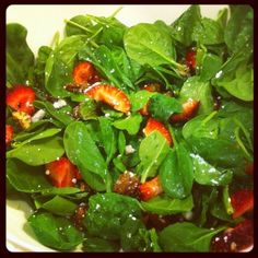 Spinach and strawberry salad with goat cheese & candied pecans