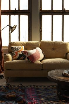 Love the colour of this sofa but the windows, rug etc are so fab too.