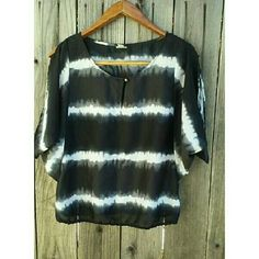 Batwing Blouse Black and white tye dye striped batwing blouse. Great condition! Feel free to negotiate a deal! Also if you bundle with another item you get 15% off of your purchase! Tops Blouses