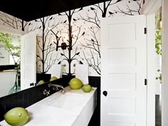 Ceiling painted black; bringing color down the wall a bit to meet wallpaper (or second paint color).