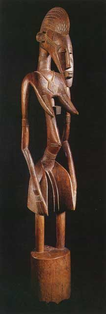 """Senufo Rhythm Pounder in the Form of a Woman - PF.2960  Origin: Northern Ivory Coast/Mali  Circa: 1870 AD to 1900 AD  Dimensions: 63.75"""" (161.9cm) high  Catalogue: V19  Collection: African  Medium: Wood"""