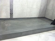Concret Shower Floor with tile walls -- easy cleaning!