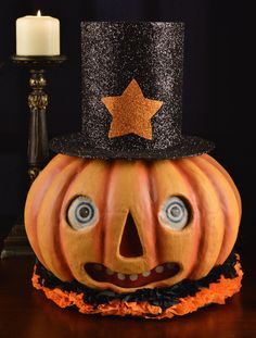 Mr. Pumpkin Lantern - Bethany Lowe – Black Bow Halloween Shoppe. Mr. Pumpkin Lantern will light up your Halloween season with his ruffled collar, glittering top hat and classic features.  Give this sweet pumpkin lantern a spooktacular glow with our orange C7 cord light - included FREE with this purchase!!  Paper mache.  17″ x 13 1/2″.  FREE SHIPPING!!