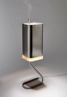The Host Lamp is designed to accommodate a fully integrated passenger appliance, a small humidifier. The principle of the host lamp is very simple – wasted heat energy Id Design, Lamp Design, Lighting Design, Cool Electronics, Yanko Design, Aroma Diffuser, How To Make Light, Industrial Design, Modern Industrial