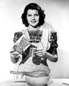 Rita Hayworth baking with short hair