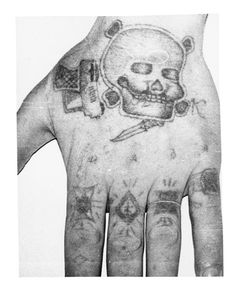 """Russian prison tattoos are a language unto themselves. The ring tattooed on his index finger means """"rely on no one but yourself."""" Spent some time going through these tattoos to figure out which ones the characters in the story will need to have. (Hint: stars on the shoulders, for sure.)"""
