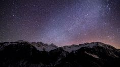 mountain with starry night sky wallpaper