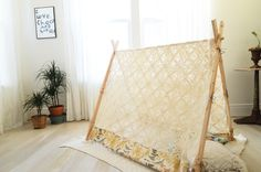 Build a Magical A-Frame Lace Tent for the Kiddos: just follow this simple tutorial by A Beautiful Mess