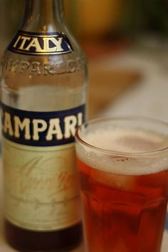 Pour 1 oz of Campari over ice, then add 6 oz of club soda and garnish it with an orange slice. One drink has fewer calories and less alcohol than a glass of wine or a beer, but the sweet, bitter taste of Campari makes it feel festive and like a treat.