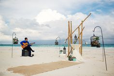 Bamboo, bird cages and flowers, a totally unique wedding ceremony set-up in Tulum at the Santa Fe Beach Club. Mexico wedding photographers Del Sol Photography.