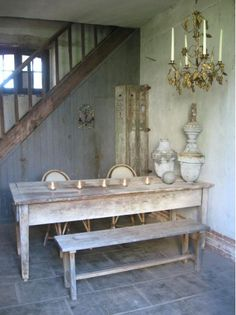Like the unusual side placement of the chandelier with antique table.. The…