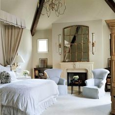 Wow! This is a fantastic romantic bedroom. Love the mirror over the fireplace.