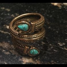 Snake Ring with Turquoise Eyes. A-M-A-Z-I-N-G!!!! Beautiful! Unique! Snake coiled ring with turquoise eyes. Amazing on your finger! Barse Jewelry Rings