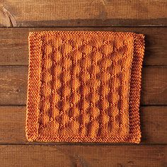 Sometimes, simple is the best. This dishcloth features knits & purls to create a fun design to brighten any kitchen. With a garter border, this is a quick knit - perfect for those who need a dishcloth right away!