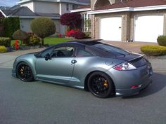 mitsubishi eclipse with lowered suspension factory aero side skirts rear bumper