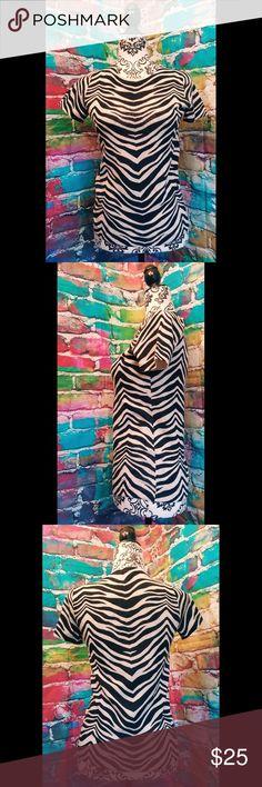 J CREW Zebra Knit Classic Short Sleeve Blouse? Gorgeous and great quality?  J CREW Zebra Knit Classic Short Sleeve Blouse?  Cream and Black Zebra stripes?  Feels like cotton?  100% Merino Wool Lightweight?  Size Small? J. Crew Tops Tees - Short Sleeve