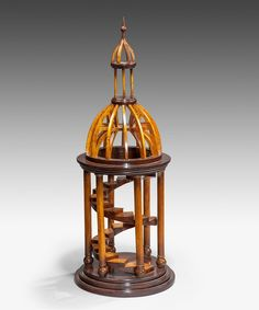 This architectural model of a dome with staircase, c.1950 would look lovely on display in a minimalist or more traditional interior! An architectural model of a dome with an internal spiral staircase; the dome raised on turned columns and open to illustrate the supporting beams. £2950