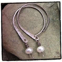 From Canadian Rockies Art of ArtFire    http://www.artfire.com/ext/shop/product_view/canadianrockiesart/446916/nylla_silky_open_hoop_earrings_in_sterling_silver_white_pearls_rustic/handmade/jewelry/body_jewelry