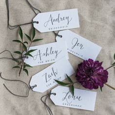 Wedding Party Name Tags | The Bride Nametag, Maid of Honor name tag, The Groom name tag, Bridesmaid name tag, fauxligraphy, hand-written, calligraphy, dark purple dahlia, nandina foliage | Photography: Evergreen Flower Co.