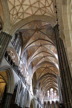ENGLISH GOTHIC: Salisbury Cathedral, begun 1220, uses fan vaulting and complex ribs. British architects were generally less interested in height and paid more attention to surface detailing and intricate stone traceries.