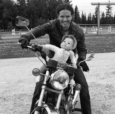 Back on the bike shooting Season 11 of Heartland! This picture was just for fun. The scene did not involve Ty and Amy's child riding on the gas tank. Heartland Season 11, Heartland Actors, Heartland Quotes, Heartland Amy, Ty Y Amy, Ty Borden, Funny Books For Kids, Graham Wardle, The Greatest Showman