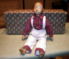 Handcarved Wood Artist Boy Doll RARE    This doll features an amazing handcarved head, arms and legs with a soft cloth filled body that is poseable.
