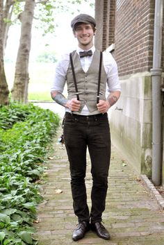 groom concept- take the exact groomsmen out fit, but add the light brown, tweed(?) vest. possibly a white bow tie instead of coloured.