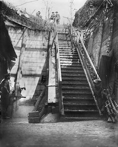 WW1, 1916, Battle of the Somme. Steps in a captured German dug-out on the Somme. German positions were exquisitely fortified with deep concrete shelters, which resisted Allied bombardments before the battle. The Germans had a tendency to construct very elaborate trenches because, as far as they were concerned, they were the new border. Some even had shuttered windows and doormats to wipe muddy feet on!