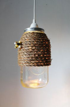 The Hive  Half Gallon Mason Jar Pendant Light  by BootsNGus, $45.00  This is cute and the site has some interesting items!..