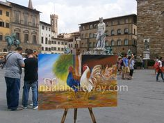 "The Sienese painter Duccio di Buoninsegna's painting of the ""Maesta"" was carried through the streets of Siena in 1311 before being placed on the main altar in the Cathedral. Here ""An Allegory of Italian Men"" (Oil on Canvas) by artist Nuala Holloway is being carried through the streets of Florence before reaching the Palazzo Strozzi"