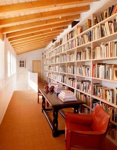 This hallway-transformed-into-a-library shows maximization of the higher, vaulted ceilings and uses simple built-ins to really spice up this small space (and adds extra book storage and a quite, well lit place to sit and read!)  I wish I had a space like this in my home.